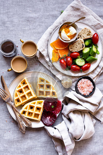 Sweet and Savory Breakfast Board with baguette, blood orange, butter, cheese, coffee, cucumber, gouda, honey, jam, maple syru...