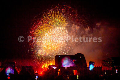 Beautiful white and yellow fireworks with red smoke and a barrage of smart phones