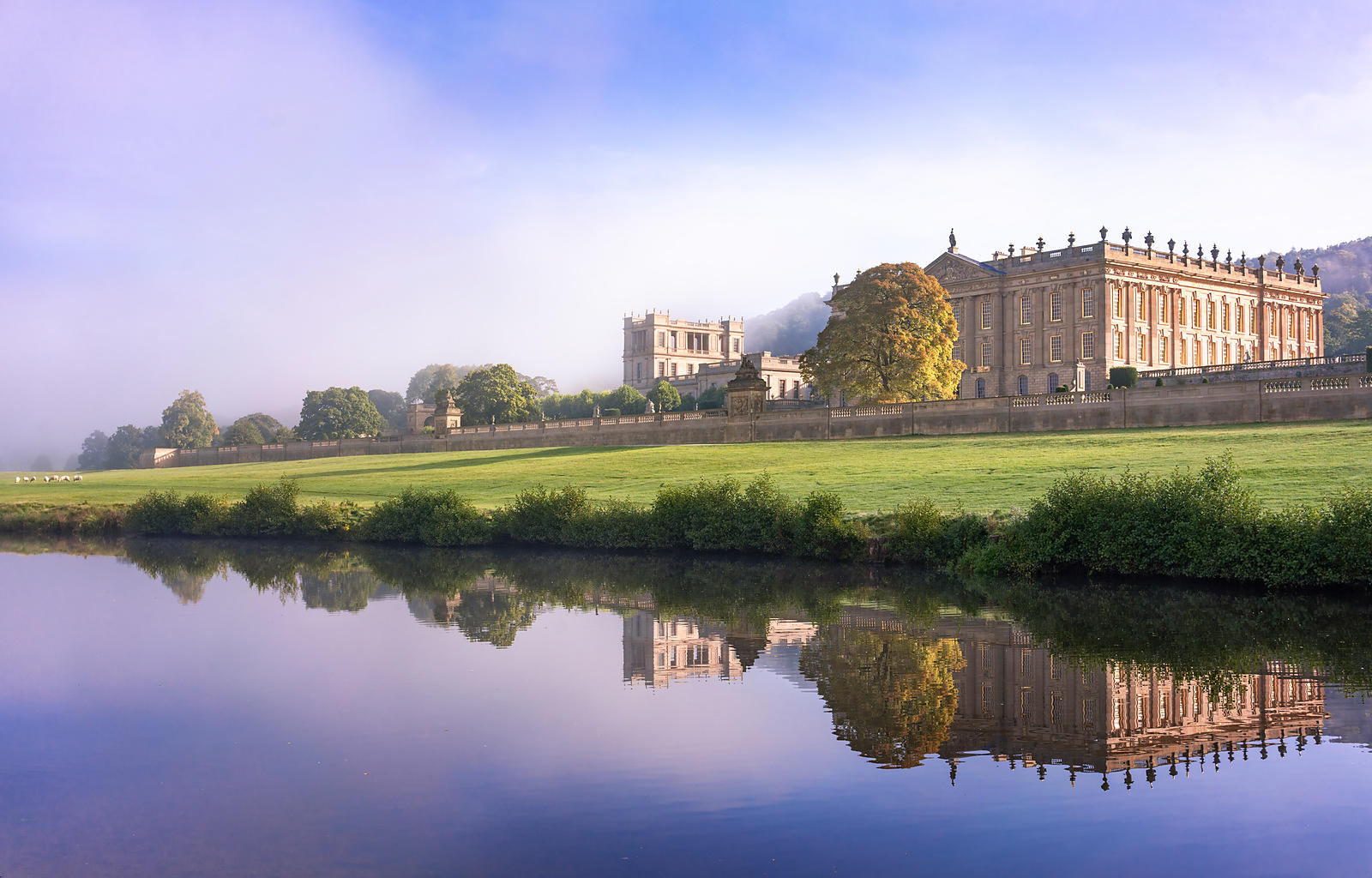Chatsworth House in clearing September mists