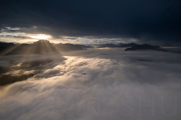 Sunrise on a sea of clouds over lake annecy
