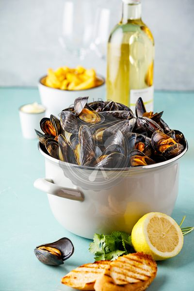 Belgian mussels in white wine with lemon, herbs, croutons and french fries