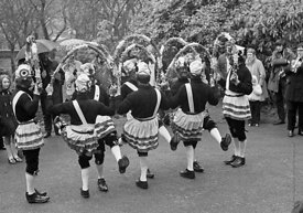#77109,  The 'Nutters' Dance', Bacup, Lancashire,  1973.  On Easter Saturday every year the 'Coconut Dancers' gather at one b...