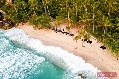 Aerial view of woman on tropical beach at sunset, Ko Samui, Thailand