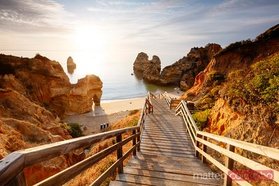Boardwalk to Camilo beach at sunrise,  Portugal