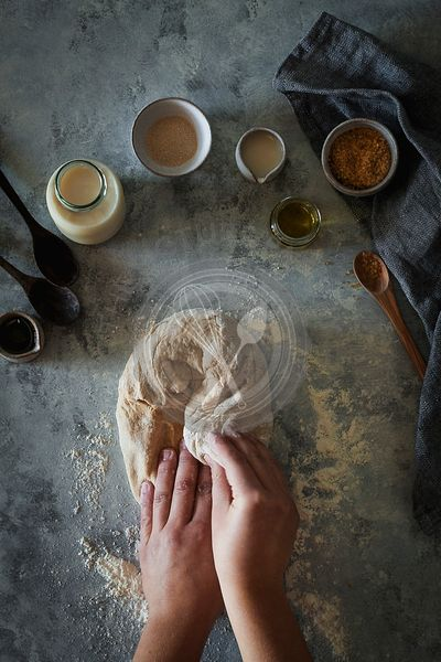 Hands kneading dough.