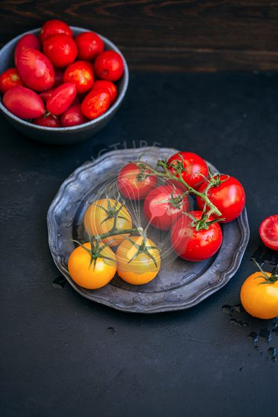 Red and yellow cherry tomatoes on a plate