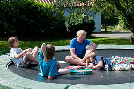 "#73099,  Philipp Klaus, holding an English class on the trampoline using the ""Upwords"" game, Summerhill School, Leiston, Suff..."