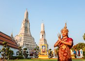 Thai dancer with traditional dress, praying, Wat Arun, Bangkok