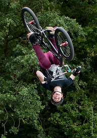 #87550  Demonstration of biking skills, Party in the Park, Woking, Surrey, 2012.