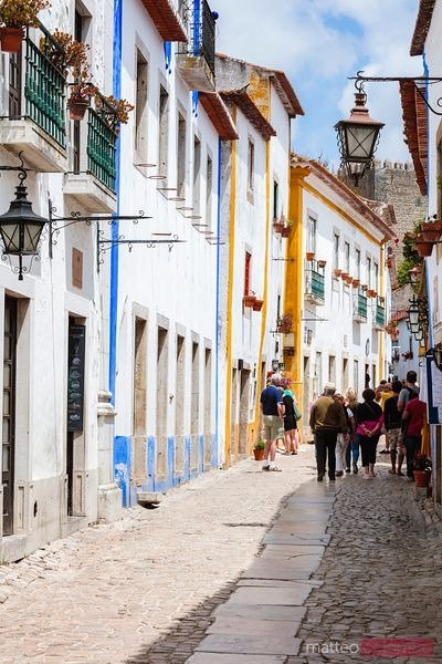 Street with colorful houses, Obidos, Portugal