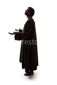 A Silhouette of a mystery man in robes – shot from eye level.