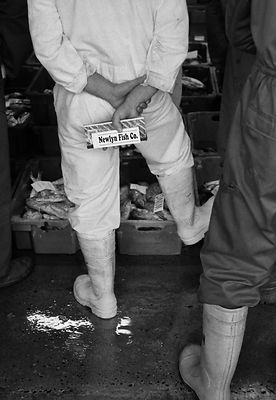 Buyers in the fish market in the Cornish port of Newlyn, England.