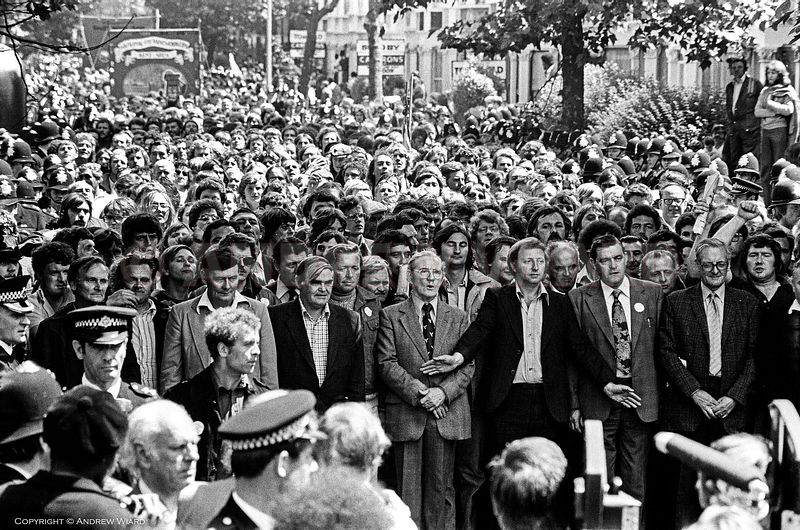 England, UK. London. 11.7.1977 . Grunwick dispute. Arthur Scargill leads the Yorkshire miners past the gates of Grunwick duri...