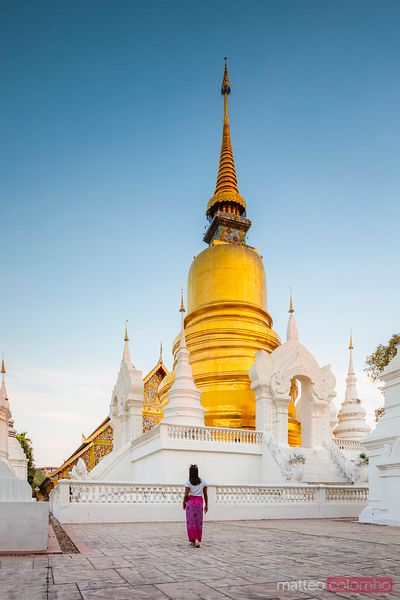 Woman looking at stupa, Wat Suan Dok, Chiang Mai, Thailand