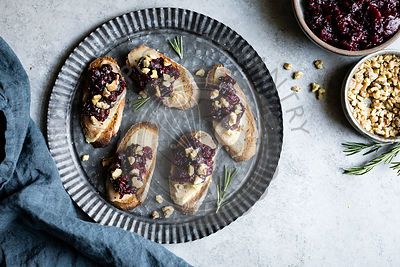 Cheese crostini with rosemary cranberry fig jam
