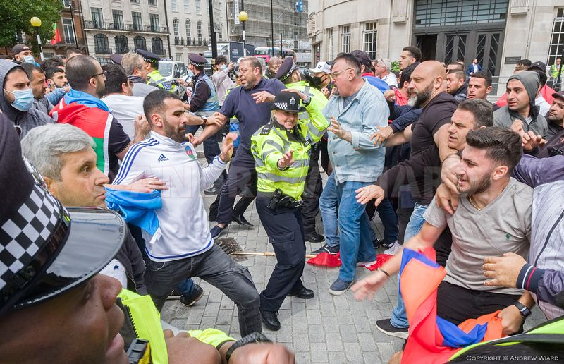 Foreshadowing the war later in the year Azerbaijani ( left )  and Armenian demonstrators face off in central London,  28.7.2020.