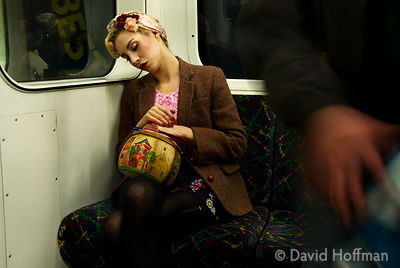 Young woman with handbag snoozing on the tube