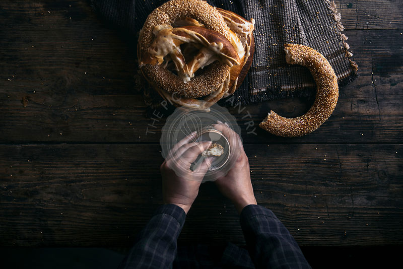 German Bread Pretzel and Bagel Breakfast on a wooden table. Black Background.
