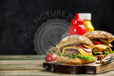 Homemade hamburgers on wooden background