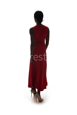 A silhouette, of a woman in a red dress – shot from eye level.
