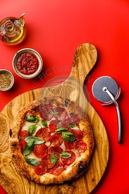 Pepperoni Pizza on red background