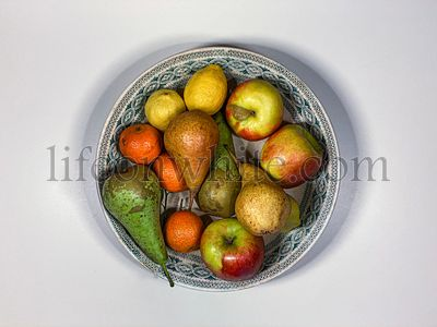 Top view of raw fruits in a old dish