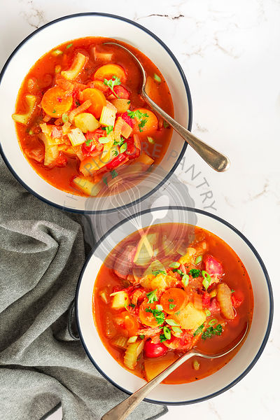 Tomato and vegetable soup with ham hock.