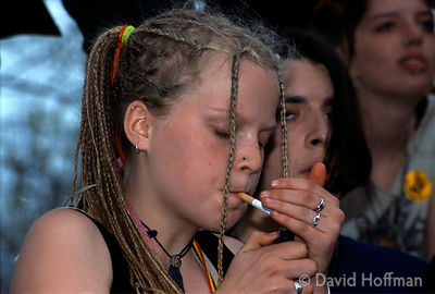 Young girl smoking with her friends, during demonstration against the Criminal Justice Bill, London.