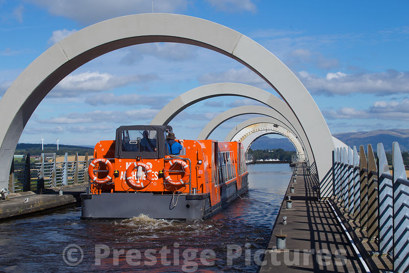 The Falkirk Wheel pleasure boat enters the upper section of the Falkirk Wheel