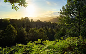 Sunset over the forests and mountains that surround Braithwaite in the Lake District, England.