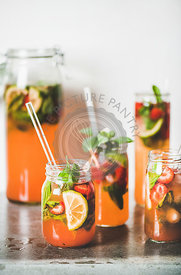 Fresh homemade strawberry and basil lemonade in tumblers with straws