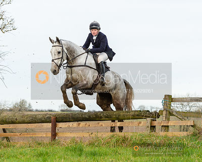 Meghan Healy jumping a fence on Bruce's Lane - The Cottesmore Hunt at Owston 19/11