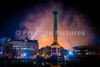 London Fireworks 2020 on News Years Eve as seen from Trafalgar Square - orange sky