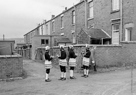 #77115,  The 'Nutters' Dance', Bacup, Lancashire,  1973.  On Easter Saturday every year the 'Coconut Dancers' gather at one b...