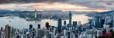 Panoramic of Hong Kong harbour and skyline at sunrise