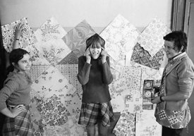 #75029  Decorating the walls with pages from a wallpaper catalogue, Liverpool Free School, Liverpool  1971.  Also known as th...