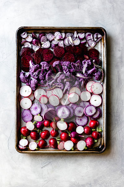 Raw vegetables on a baking tray.