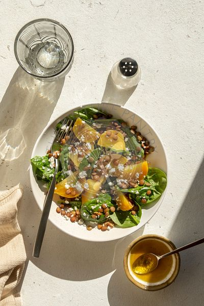 Golden beet salad with green lentil,feta cheese and spinach in a bowl
