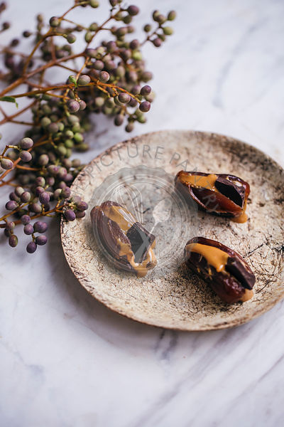 Dates filled with peanut butter and dark chocolate