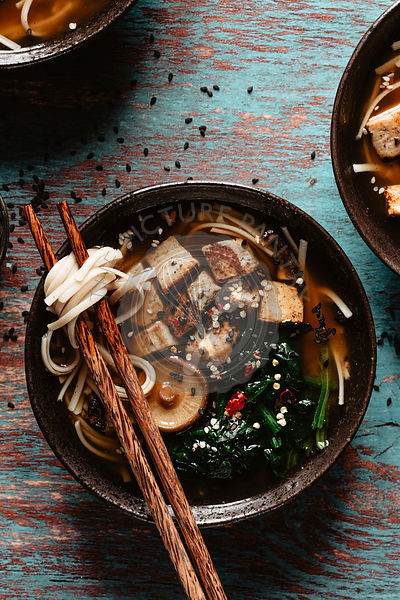 Asian miso soup with mushrooms into a bowl