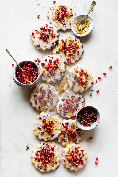 Gluten-free Sugar Cookies with eggless glaze decorated with pomegranate seeds, rose petals and pistachio