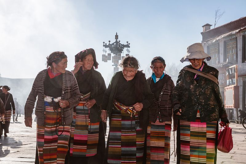 Old local women in Barkhor square, Lhasa, Tibet