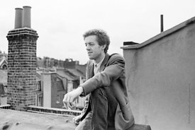 #74842,  Cornelius Cardew, 1970,  Cornelius Cardew (1936-1981), avant-garde musician and composer, on the rooftops, Fitzrovia...