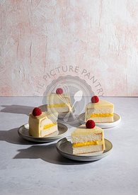 Citrus cake slices with raspberries and citrus curd