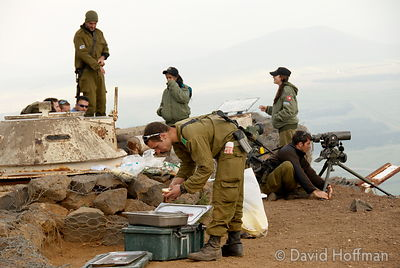 Soldiers during a meal break at a defensive emplacement in the Golan Heights, Israel.