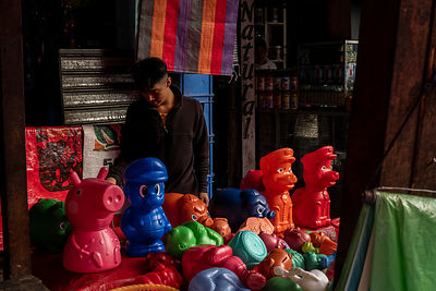A boy at a stall selling colourful toys inside the Mercado Terminal