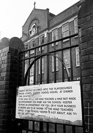 #76362  Large sign on the gates of a Roman Catholic Primary school illustrating how unwelcoming some schools were in those da...