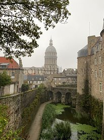 Basilica of Our Lady of the Immaculate Conception at the fortified city of Boulogne-sur-Mer, castle in foreground. Cloudy and...