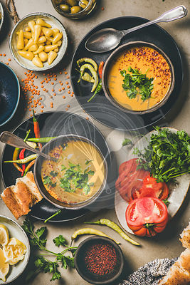 Flat-lay of Turkish lentil soup Mercimek with parsley and flatbread