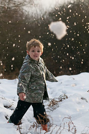 Young boy throws a snowball Kelling Norfolk December